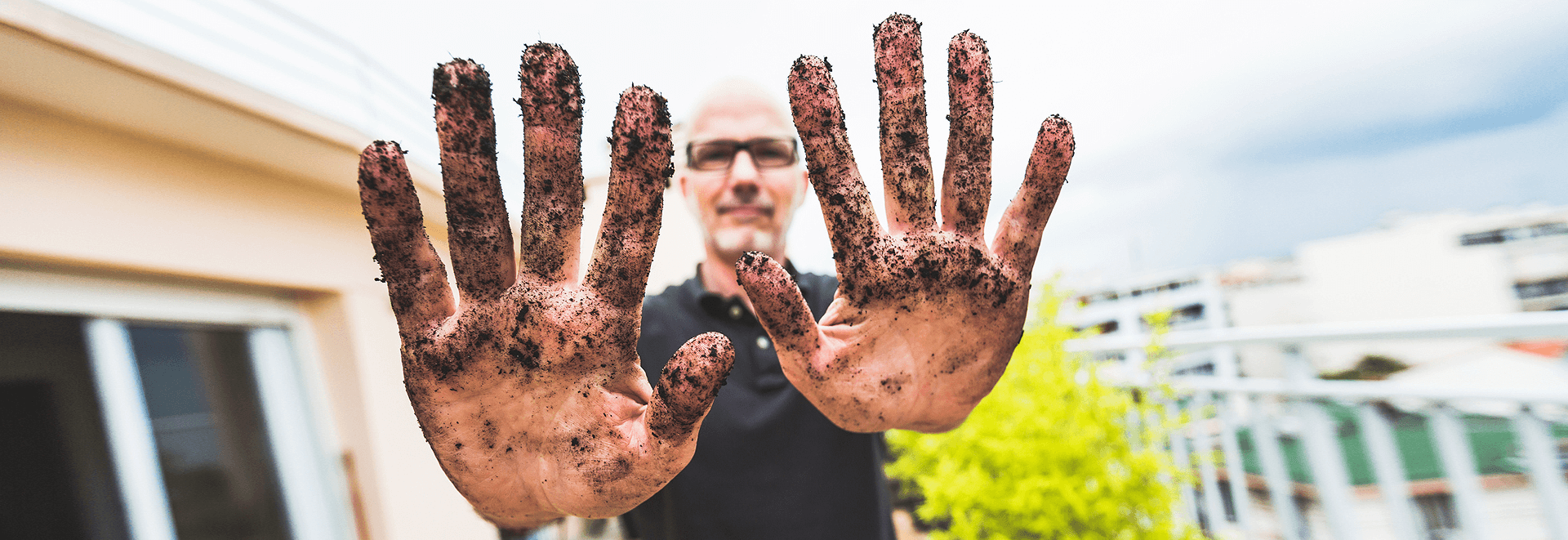Man with dirt in hands